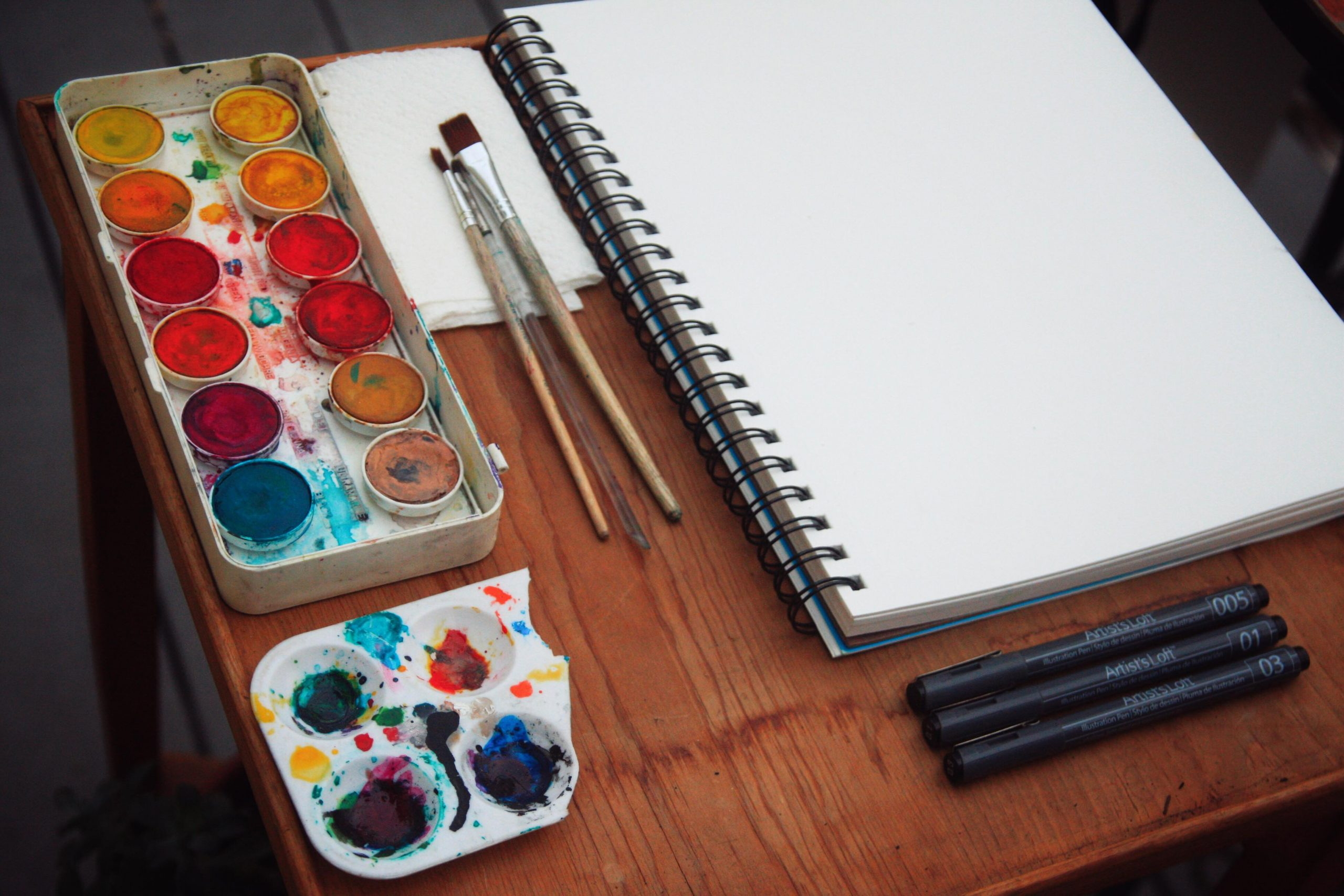 watercolor paint palet and notebook