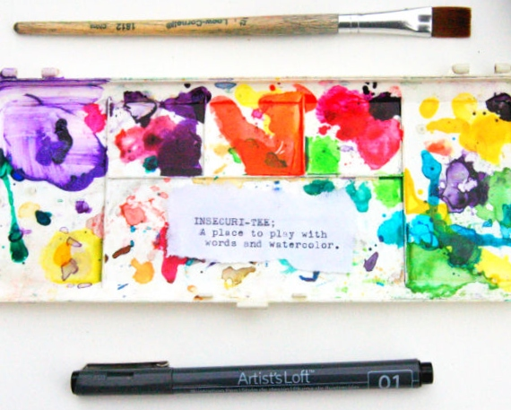 """A watercolor mixing palette framed by a ink pen and paint brush. The phrase """"Insecuri-tee; a place to play with words and watercolor."""""""